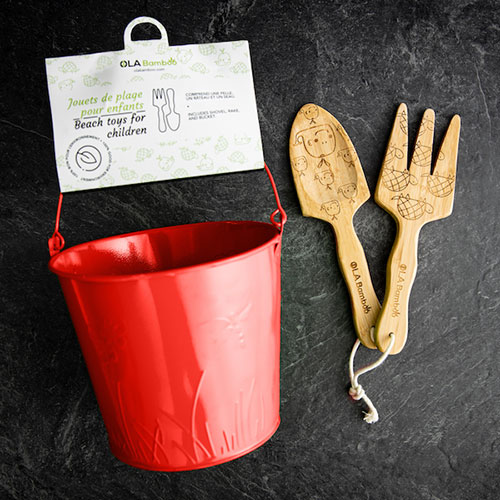 beach toys for children - wooden shovel, rake and a red tin bucket