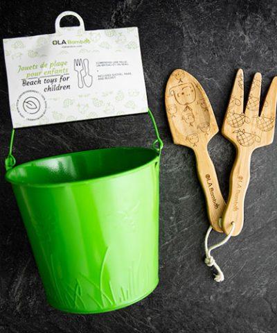 beach toys for children - wooden shovel, rake and a green tin bucket