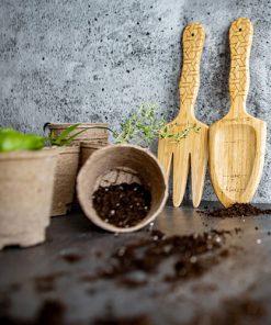 wooden shovel and rake for gardening